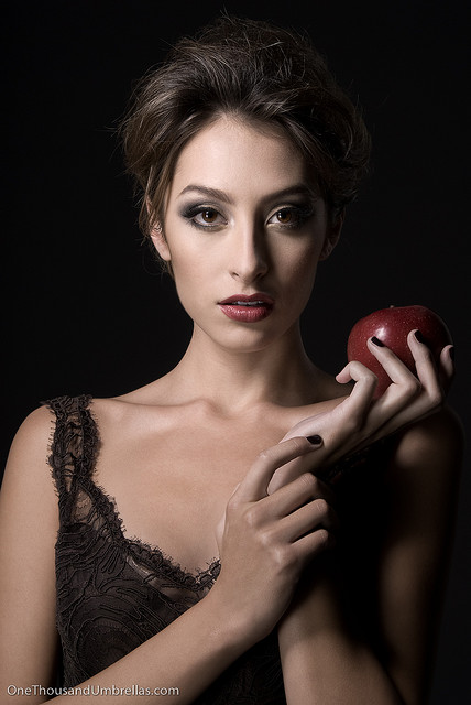 I don't have any photos of tasers or weapons, but I do have a photo of an apple. Beautiful model holding it is an extra bonus.